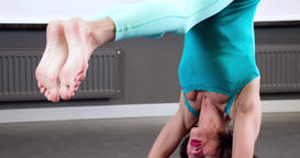 Woman doing yoga exercise 4k close-up video. Girl head arms Headstand asana Footage
