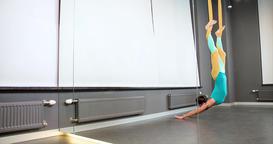 Woman doing aerial flow yoga exercise hammocks 4k video gravity fitness studio Footage