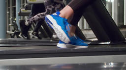 Close-up running legs foots on treadmill machine gym HD slow-motion video Footage