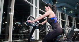 Woman cardio gym training 4k close-up video. Fitness girl on stationary bicycle Footage