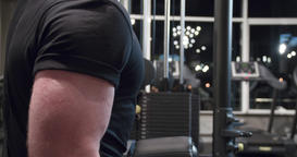 Man arm biceps training dumbbells gym 4k close-up video. Male weight exercise Footage