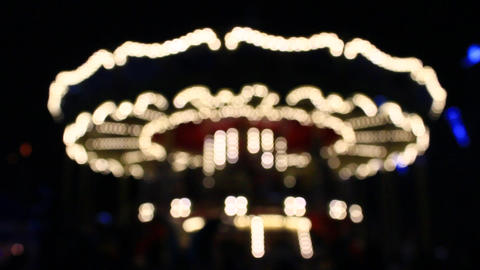 blurred lights of revolving carousel in the New Year holidays in Chernihiv in th Footage