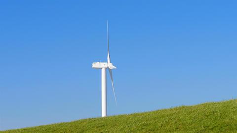 Wind turbine behind levee Netherlands Footage