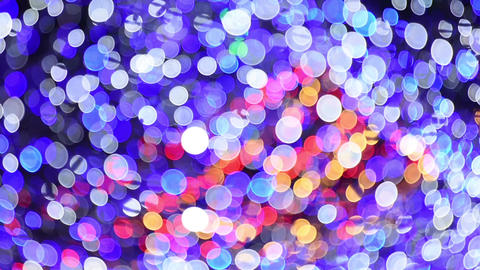 Abstract background of moving blurred colored lights garland Live Action