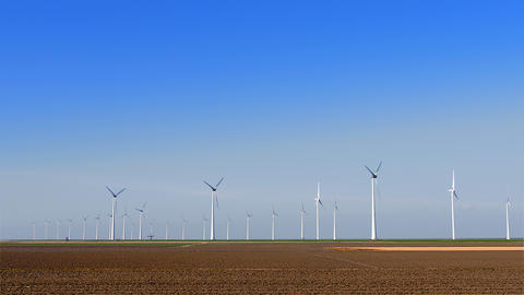 Group of wind turbines at farmland Footage