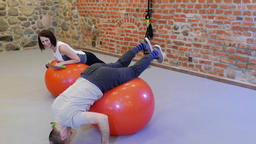Man is Working Out With a Personal Trainer at fitness center. Funny Footage