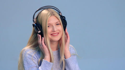 Charming girl with headphones listening to music Footage