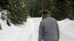 Speed forestry worker who goes on a road covered with snow in the woods 07 Footage
