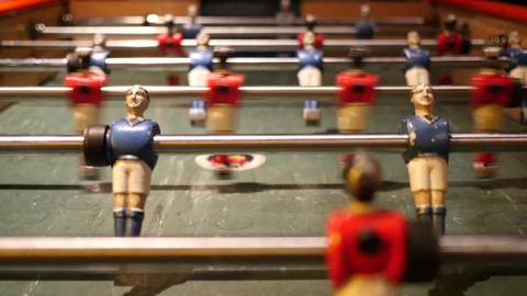 Football players rotating on the table of a sports club 95 Footage