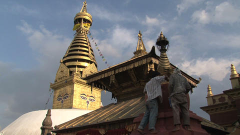 Man painting a stupa Stock Video Footage