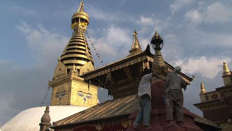 Man painting a stupa Footage