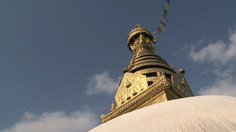 Golden top of the Swayambhunath stupa, monkey Footage