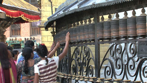 People spinning the prayer wheels Stock Video Footage