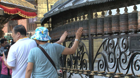 People Spinning The Prayer Wheels stock footage