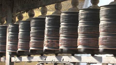 Hands touching the prayer wheels Stock Video Footage