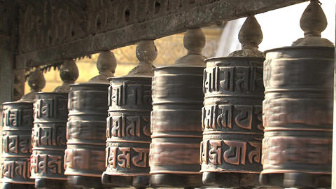 People touching the prayer wheels Stock Video Footage