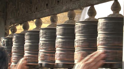 People touching the prayer wheels Footage