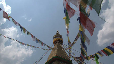 Prayer flags in the wind reaching the top Stock Video Footage