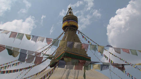 Prayer flags in the wind in front of the Boudha st Stock Video Footage