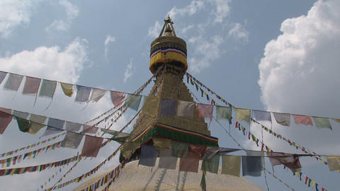 Prayer flags in the wind in front of the Boudha st Footage