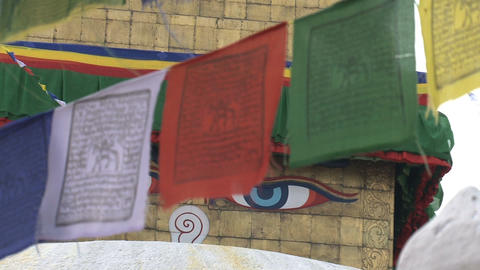 Focus at the prayer flags in front of the Boudha stupa Stock Video Footage