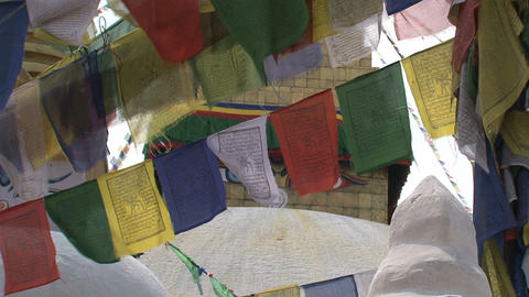 Prayer flags with the Boudhanath Stupa eyes behind Stock Video Footage