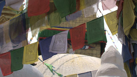 Prayer flags with the Boudhanath Stupa eyes behind Footage