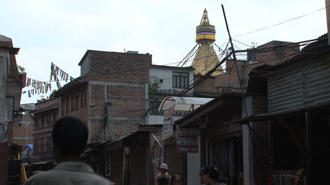 Street behind the Boudhanath Stupa Stock Video Footage