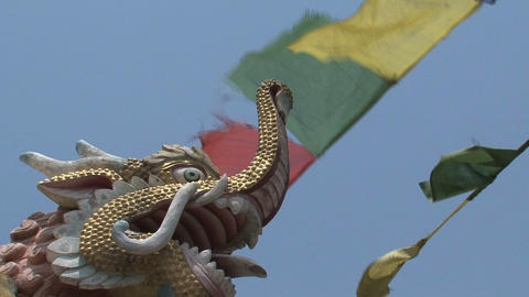 Dragonhead with prayer flags Stock Video Footage
