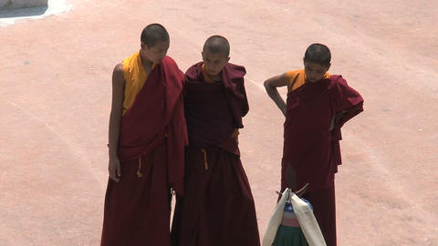 3 young monks at the Boudha stupa Stock Video Footage