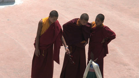 3 young monks at the Boudha stupa Footage