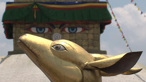 Focus from Boudhanath Stupa eyes to Golden brahma Stock Video Footage