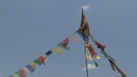 Prayer flags with a buddhist flag Stock Video Footage