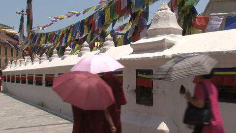 Monks walking around the Boudha stupa Stock Video Footage