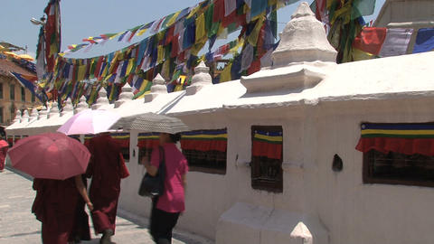 Monks walking around the Boudha stupa Footage