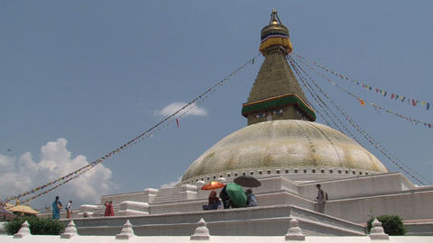 People walking on and around the Boudha stupa Stock Video Footage