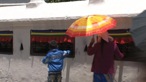 people turning the prayer wheels Stock Video Footage