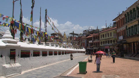 People walking around the Boudhanath stupa Stock Video Footage