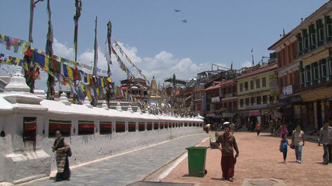 People walking around the Boudhanath stupa Footage