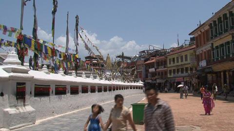 People walking around the Boudhanath stupa Stock Video Footage