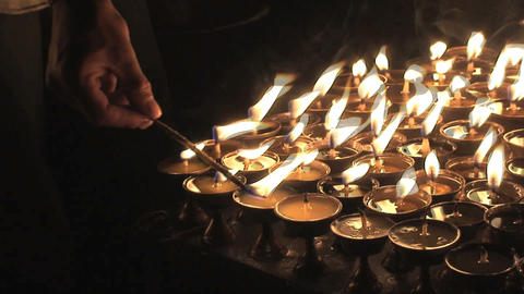 Turning on candles during Buddha's birthday Stock Video Footage