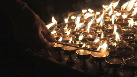 Turning on candles during Buddha's birthday Footage