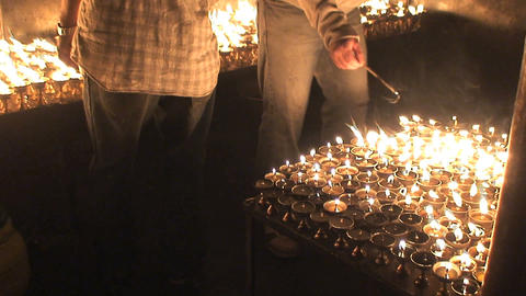 Turning on candles Stock Video Footage