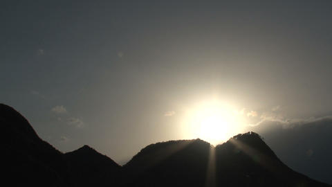 Sunshine behind the clouds time lapse Stock Video Footage