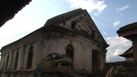 Tilt to lions statues in front of a temple in Nuwa Stock Video Footage