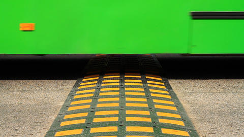 Speed bump on a road Stock Video Footage