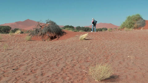 woman walking trough the dunes Stock Video Footage
