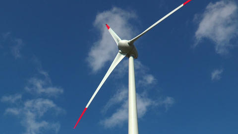 rotating wind generator with moving clouds Stock Video Footage
