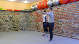 Fitness training with personal trainer at fitness center Footage