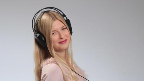 Emotional girl in headphones listening music Footage